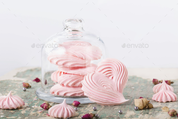 Heart shaped meringues in glass cookie jar and around - Stock Photo - Images