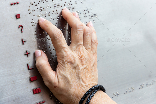 Finger reading braille tactile on public park message board - Stock Photo - Images