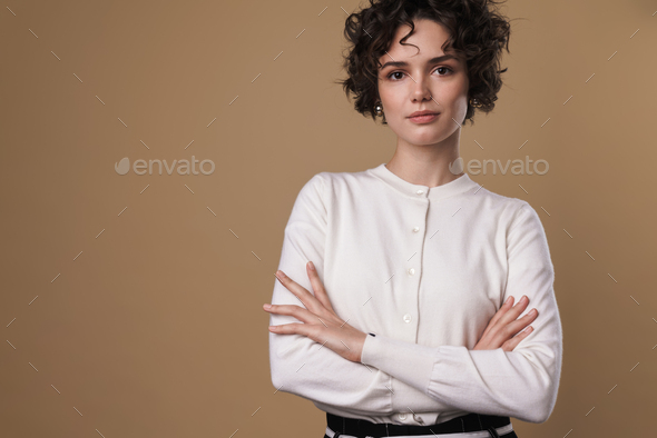 Image of confident caucasian woman posing and looking at camera - Stock Photo - Images