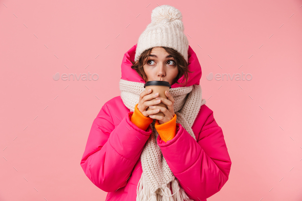 Portrait of beautiful cute woman looking aside and drinking coffee - Stock Photo - Images