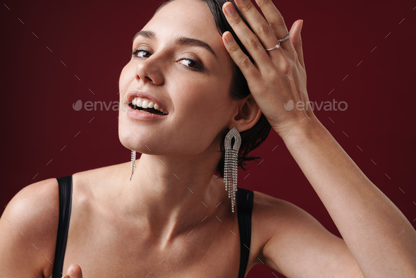 Beautiful young brunette woman wearing cocktail dress - Stock Photo - Images