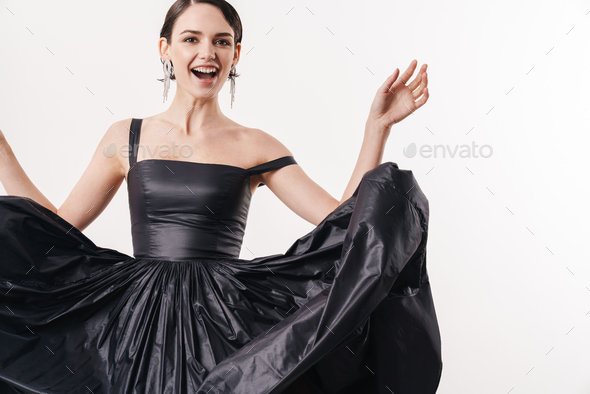 Image of pretty brunette young woman wearing dress smiling at camera - Stock Photo - Images
