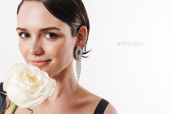 Image of charming young pretty woman smiling and holding white flower - Stock Photo - Images