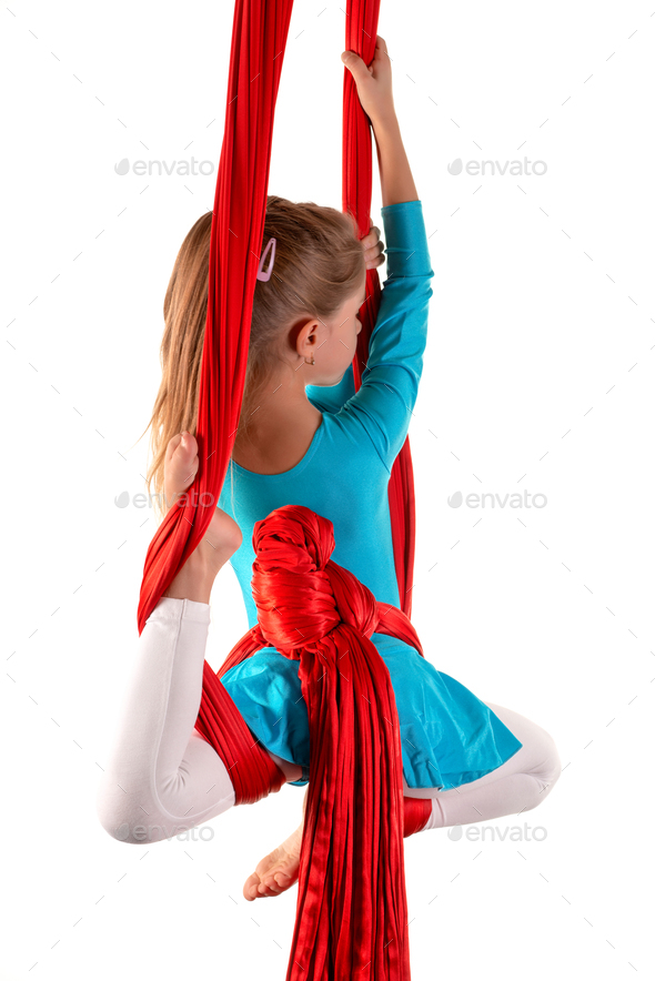 Pretty little girl in a blue gymnastic suit - Stock Photo - Images