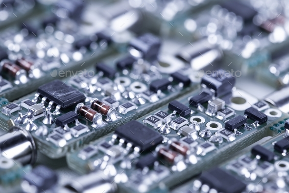 Closeup small microcircuits lie next to each other - Stock Photo - Images