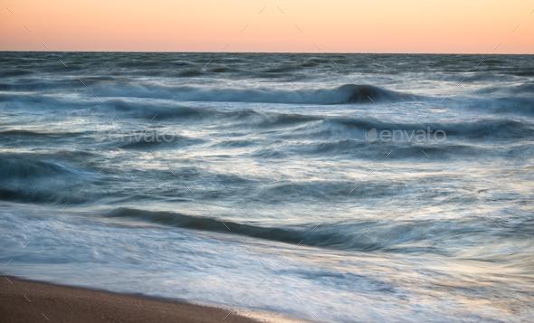 Fascinating sea waves splash along the sandy beach - Stock Photo - Images