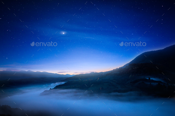 Fantastic night sky over mountains - Stock Photo - Images