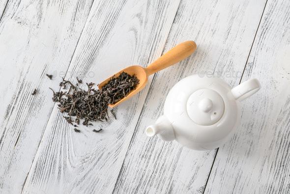 Porcelain teapot with tea - Stock Photo - Images