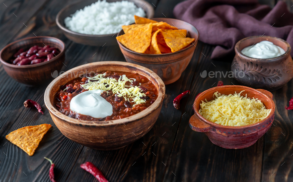 Bowl of chili con carne with the ingredients - Stock Photo - Images