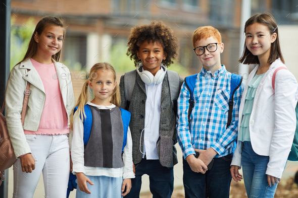 Group of elementary students outdoors - Stock Photo - Images