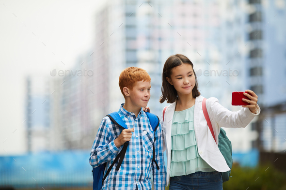 Two friends making selfie portrait - Stock Photo - Images