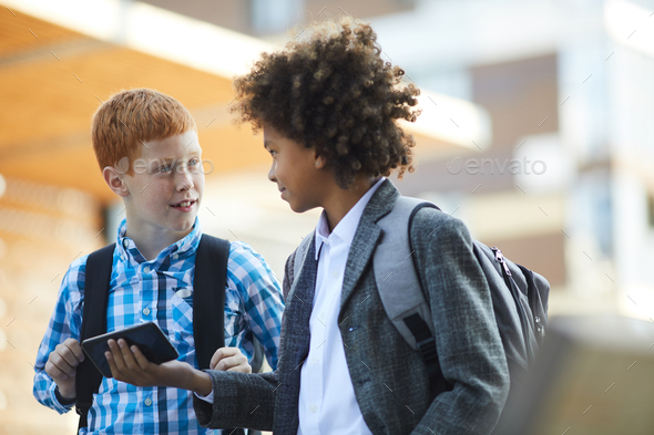 Schoolboys with mobile phone - Stock Photo - Images