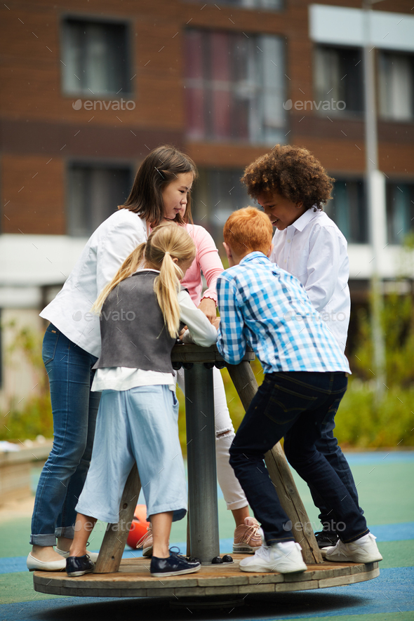 Children playing on the playground - Stock Photo - Images