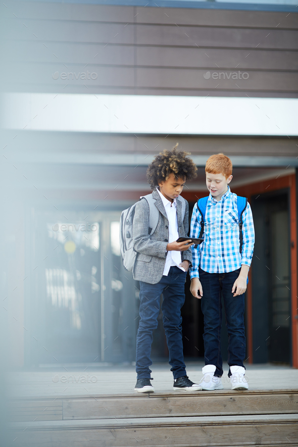 Two boys using mobile phone - Stock Photo - Images
