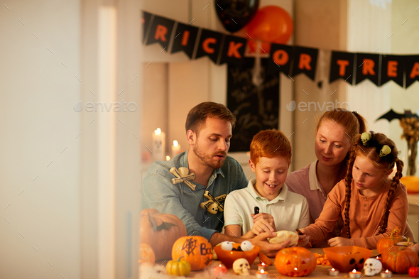 Family spending time together at home - Stock Photo - Images