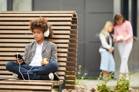 African boy resting on the bench - Stock Photo - Images