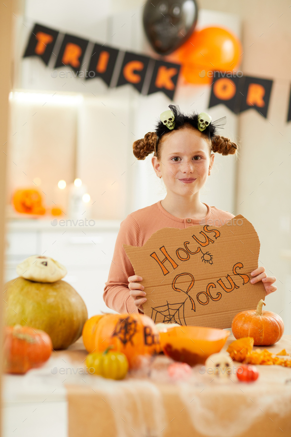 Little girl at Halloween party - Stock Photo - Images