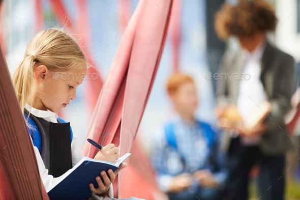 Schoolgirl doing homework - Stock Photo - Images