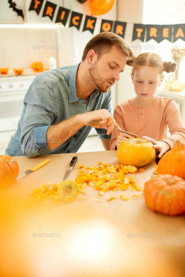 Family preparing pumkins for holiday - Stock Photo - Images