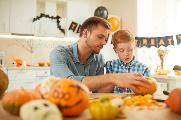 Family with pumpkins at home - Stock Photo - Images