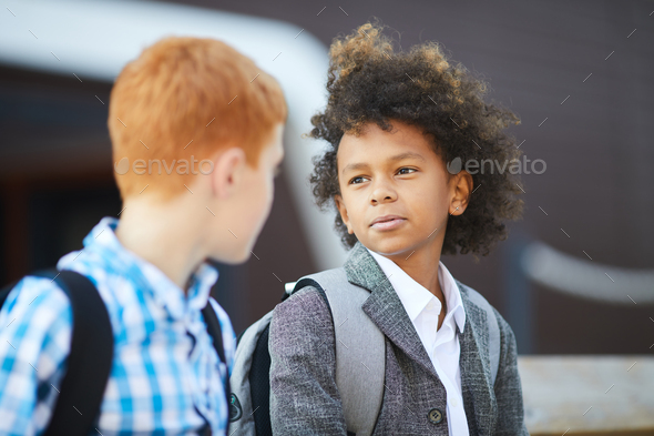 Two boys talking outdoors - Stock Photo - Images