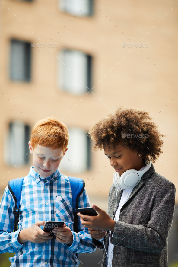 Friends playing online games - Stock Photo - Images
