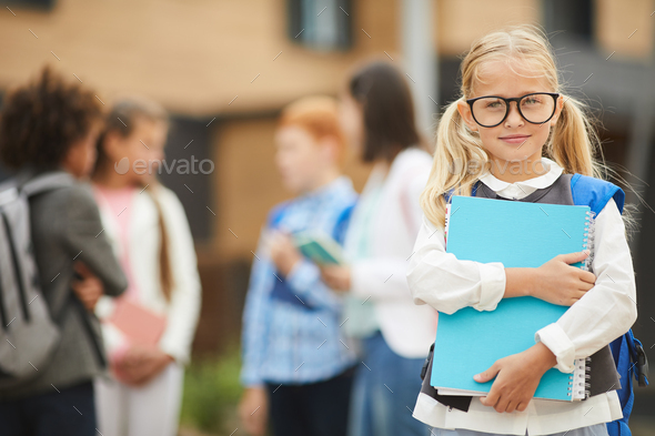 Schoolgirl studying at school - Stock Photo - Images