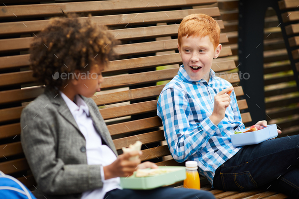 Children have a snack together - Stock Photo - Images