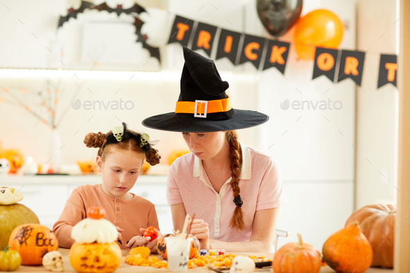 Mother with daughter celebrating Halloween - Stock Photo - Images