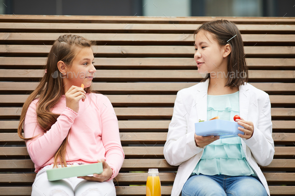 Schoolgirls have a lunch at school - Stock Photo - Images