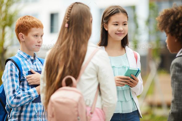 School children standing outdoors - Stock Photo - Images