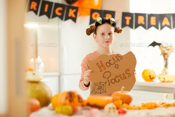 Little witch at Halloween party - Stock Photo - Images