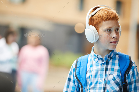 Schoolboy listening to music - Stock Photo - Images
