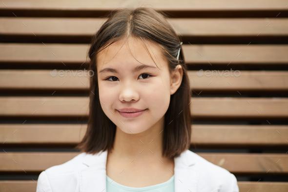 Asian schoolgirl outdoors - Stock Photo - Images