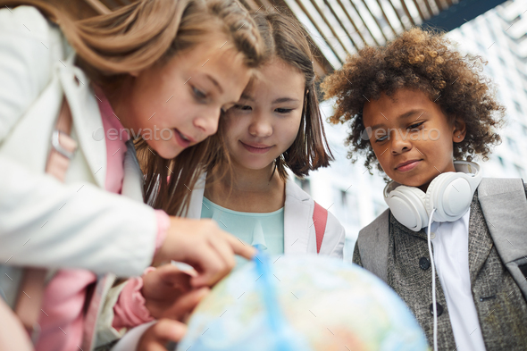 Children interested by geography - Stock Photo - Images