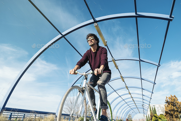 Handsome young man with fixed gear bicycle. - Stock Photo - Images