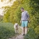 Man with dog on footpath - PhotoDune Item for Sale