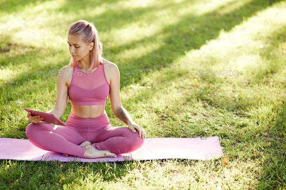 Woman watching the lesson of yoga - Stock Photo - Images
