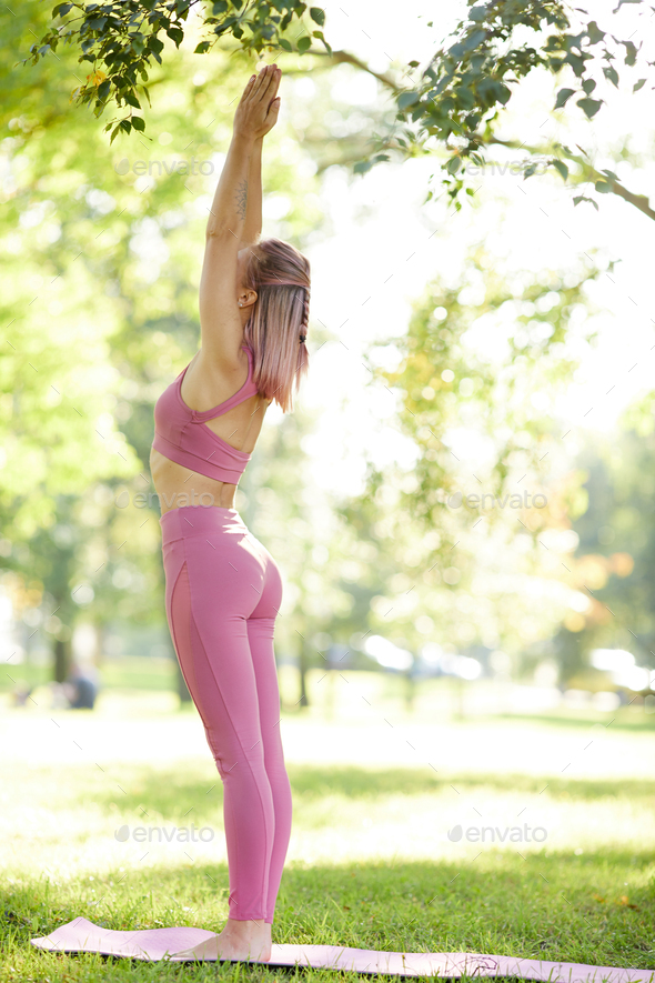 Girl exercising in the park - Stock Photo - Images