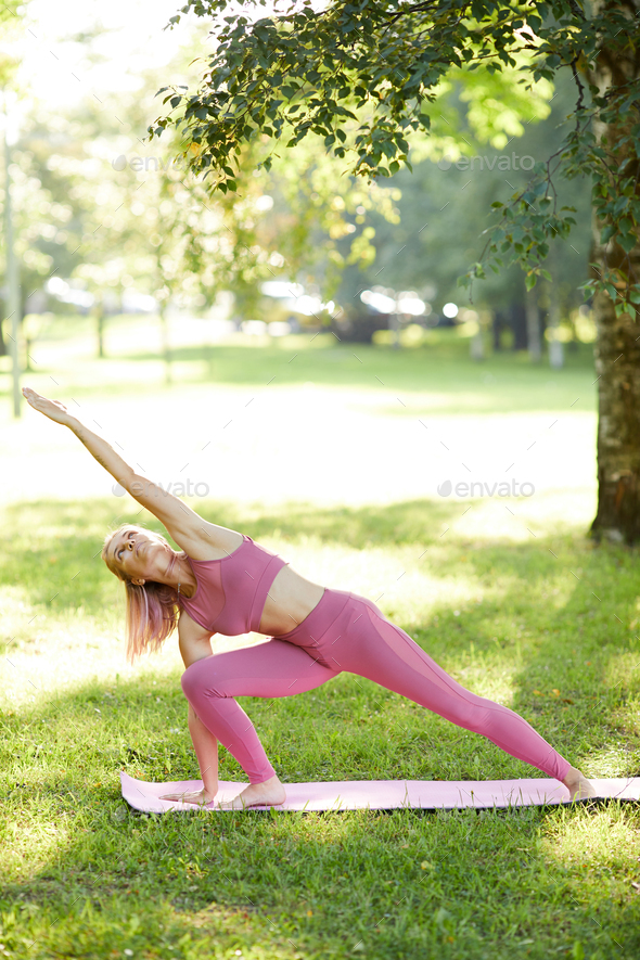 Woman stretching outdoors - Stock Photo - Images