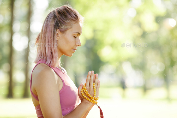 Woman listening to her mind - Stock Photo - Images