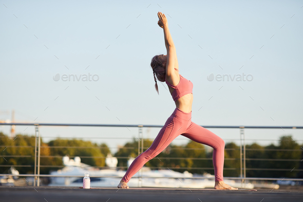 Woman practicing yoga in the city - Stock Photo - Images