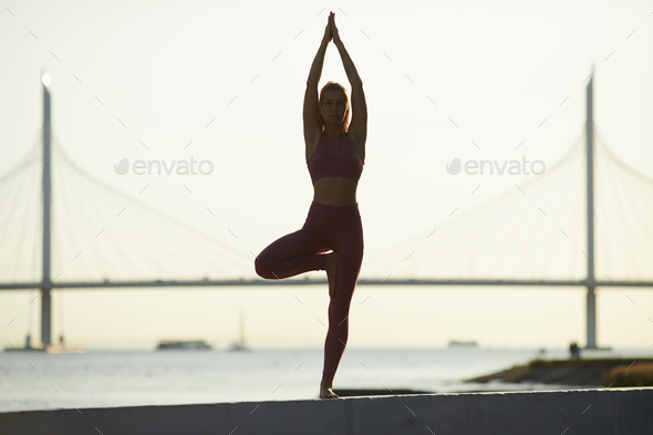 Woman doing yoga in the city - Stock Photo - Images