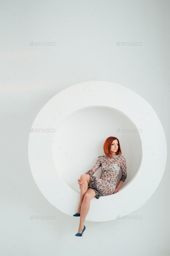 red-haired model girl on a white circle background - Stock Photo - Images