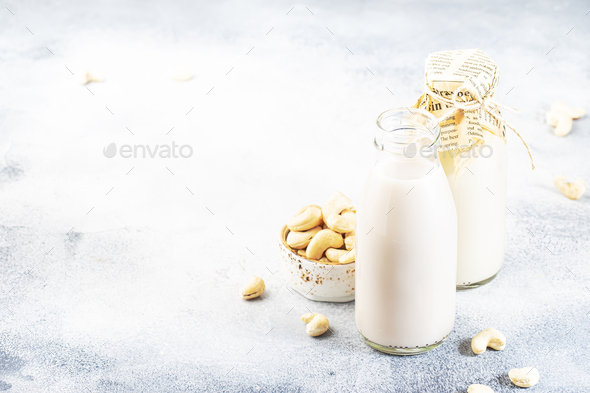 Vegan Cashew nut milk in bottles - Stock Photo - Images
