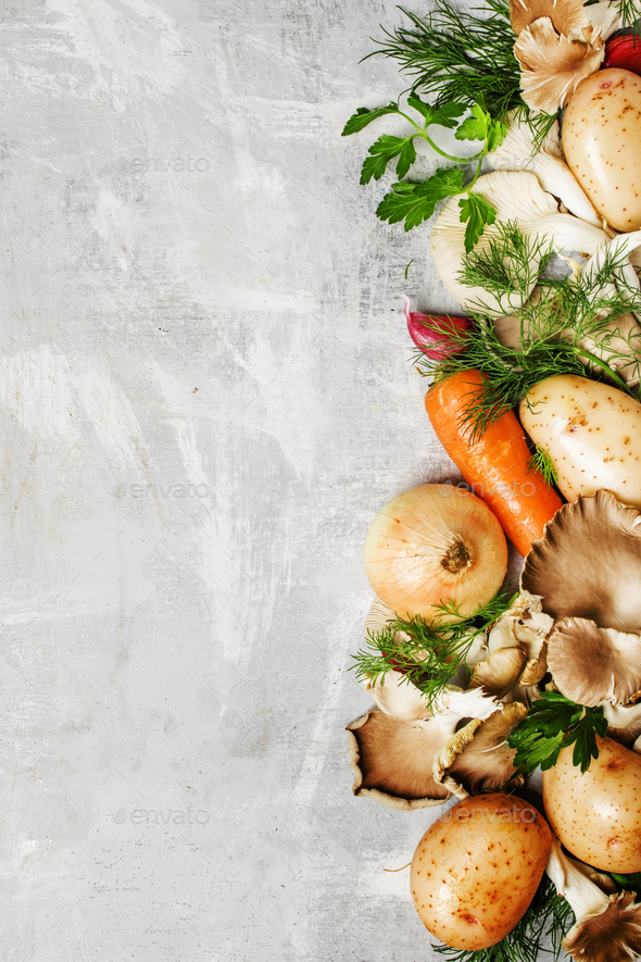 Raw potatoes, oyster mushrooms, carrots, onions, parsley, garlic and dill - Stock Photo - Images