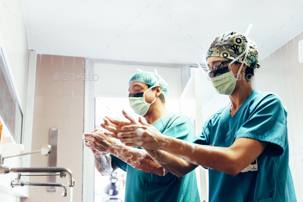 Couple of Surgeons Washing Hands Before Operating. - Stock Photo - Images