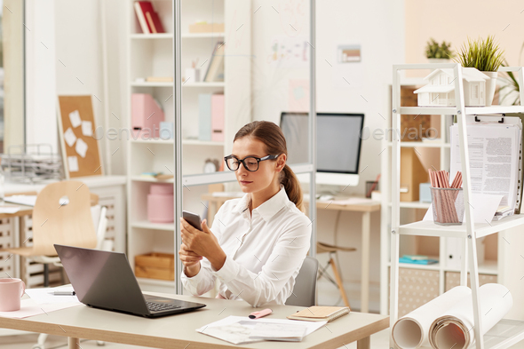 Businesswoman sitting at office - Stock Photo - Images