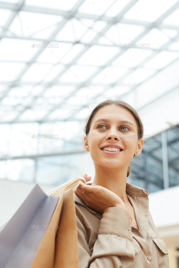 Happy woman in the store - Stock Photo - Images