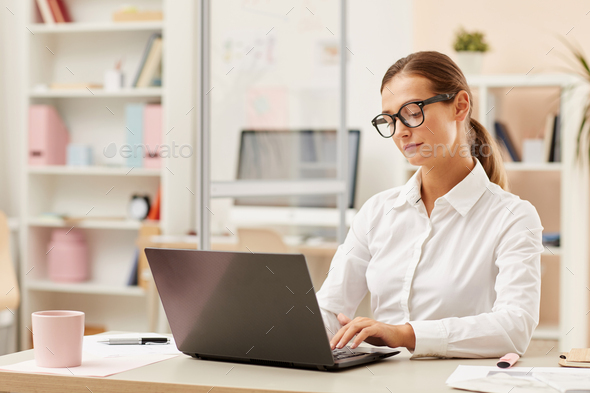 Businesswoman working on laptop - Stock Photo - Images